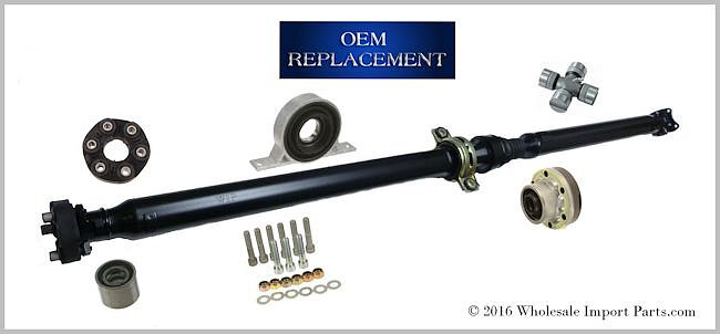 Driveshaft Assembly Explored With its Individual Components, a CV Joint, Center Support Bearing and Universal Joint.